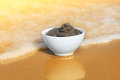 Dead sea mud in a bowl on the seashore Royalty Free Stock Photos