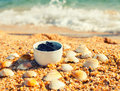 Dead sea mud in a cup on the beach Royalty Free Stock Photo
