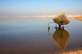 Dead sea view boat reflecting in the mirror surface of the Royalty Free Stock Photo