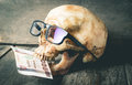 Dead Skull eating money represent corruption Royalty Free Stock Photo