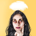 Dead zombie business woman brainstorming a idea stressed undead businesswoman under cloud of chaos and turmoil way out of the haze Stock Photos