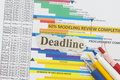 Deadline abstract newspaper cutout with schedule chart background Royalty Free Stock Images
