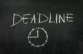 Deadline and clock drawed on blackboard with chalk Stock Photo
