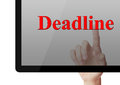 Deadline concept touch on screen with index finger Stock Image