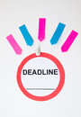 Deadline sign and sticky notes a round on white background with copy space for date with colorful Royalty Free Stock Images