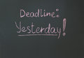 Deadline yesterday inscription in chalk on a blackboard Stock Image