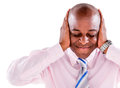 Deaf business man covering his ears isolated over white background Stock Photos
