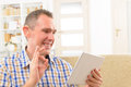 Deaf man using sign language on the tablet smiling talking tablets s cam Royalty Free Stock Photos