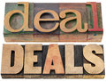 Deal and deals words isolated text in letterpress wood type Royalty Free Stock Images