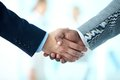 Deal is done close up of business people shaking hands to confirm their partnership Royalty Free Stock Photography