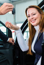 Dealer female client and auto in car dealership seller or salesman or customer presenting the interior decoration of new used cars Stock Photography
