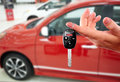 Dealer hand with a car key. Royalty Free Stock Photo