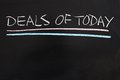 Deals of today words written on the chalkboard Royalty Free Stock Photo