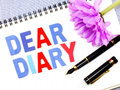 Dear diary word on white paper notebook background Royalty Free Stock Photo