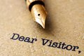 Dear visitor close up of concept Royalty Free Stock Photography