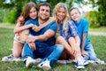 Dearest portrait of children embracing their parents Stock Photography