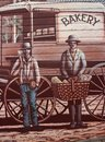 Deatail wall painting belgrave victoria men workers working wagon cart wheel wheels baker baking historic history past pastimes Stock Photography