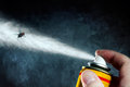 Death of a fly man spraying on poisonous aerosol Royalty Free Stock Images