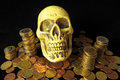 Death and money concept skull currency over a black background Royalty Free Stock Image