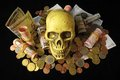 Death money concept skull and currency over a black background Royalty Free Stock Images