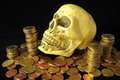 Death money concept skull and currency over a black background Stock Photography
