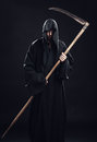 Death with scythe standing in the dark Stock Photography
