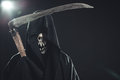 Death with scythe standing in the dark Stock Image