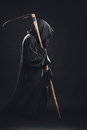 Death with scythe standing in the dark Royalty Free Stock Photography