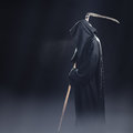 Death with scythe standing in fog the at night Stock Photography