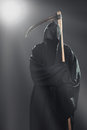 Death with scythe standing in the fog at night Stock Images