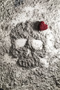 Death skull with red love heart made of ash Royalty Free Stock Photo