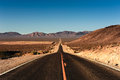 Death valley road ws the into usa from the nevada side morning light big blue sky big copy space Stock Photos