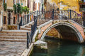 Deatil old architecture in venice narrow canal among colorful brick houses italy Stock Photography