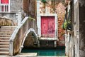 Deatil old architecture in venice narrow canal among colorful brick houses italy Stock Photos