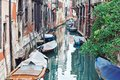Deatil old architecture in venice narrow canal among colorful brick houses italy Royalty Free Stock Photography