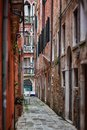 Deatil old architecture in venice narrow street among colorful brick houses italy Stock Image