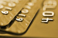 Debit cards in golden tone with shallow depth of field macro shot Royalty Free Stock Image