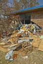 Debris in front of house heavily hit Royalty Free Stock Images