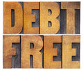Debt free in wood type financial concept isolated text vintage letterpress Stock Photography