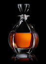 Decanter on black of cognac a background Stock Images