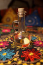 Decanter of flavored vinegar on the embroidered tablecloth in an asian restaurant Royalty Free Stock Photo