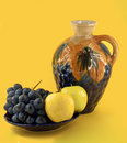 Decanter with fruits Stock Photos