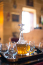 Decanter with glasses on the table Royalty Free Stock Image