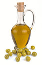 Decanter with olive oil isolated on white background Royalty Free Stock Images