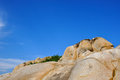 Decayed granite under blue sky weathering and in fujian south of china as featured geology landforms with wonderful pattern and Royalty Free Stock Photography