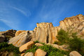 Decayed granite under blue sky weathering and in fujian south of china as featured geology landforms with wonderful pattern and Royalty Free Stock Image