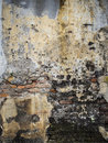 Decaying weathered textured wall old with peeling paint and exposed bricks Royalty Free Stock Photos