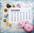 Planning your Christmas budget concept. December 2019 calendar with christmas toys and piggy bank Royalty Free Stock Photo