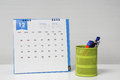December calendar on office desk with stationary box Royalty Free Stock Photo