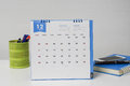 December calendar with stationary box and notebook on businesswoman desk Royalty Free Stock Photo